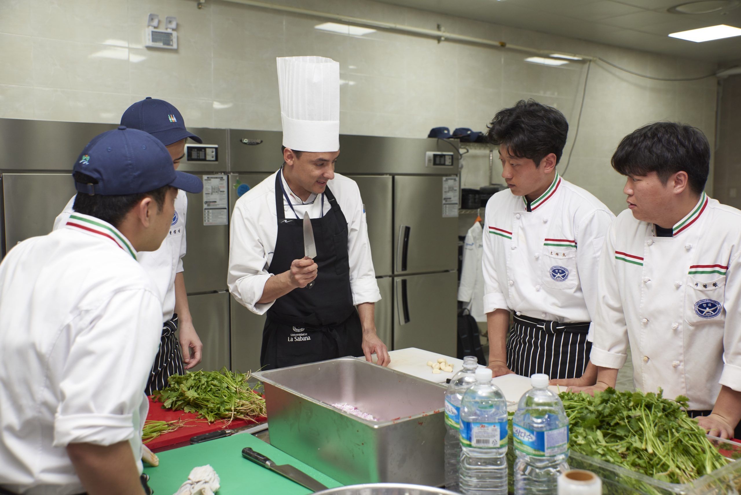 Student Chefs Preparing Food with Daniel Prada Chef from Columbia.