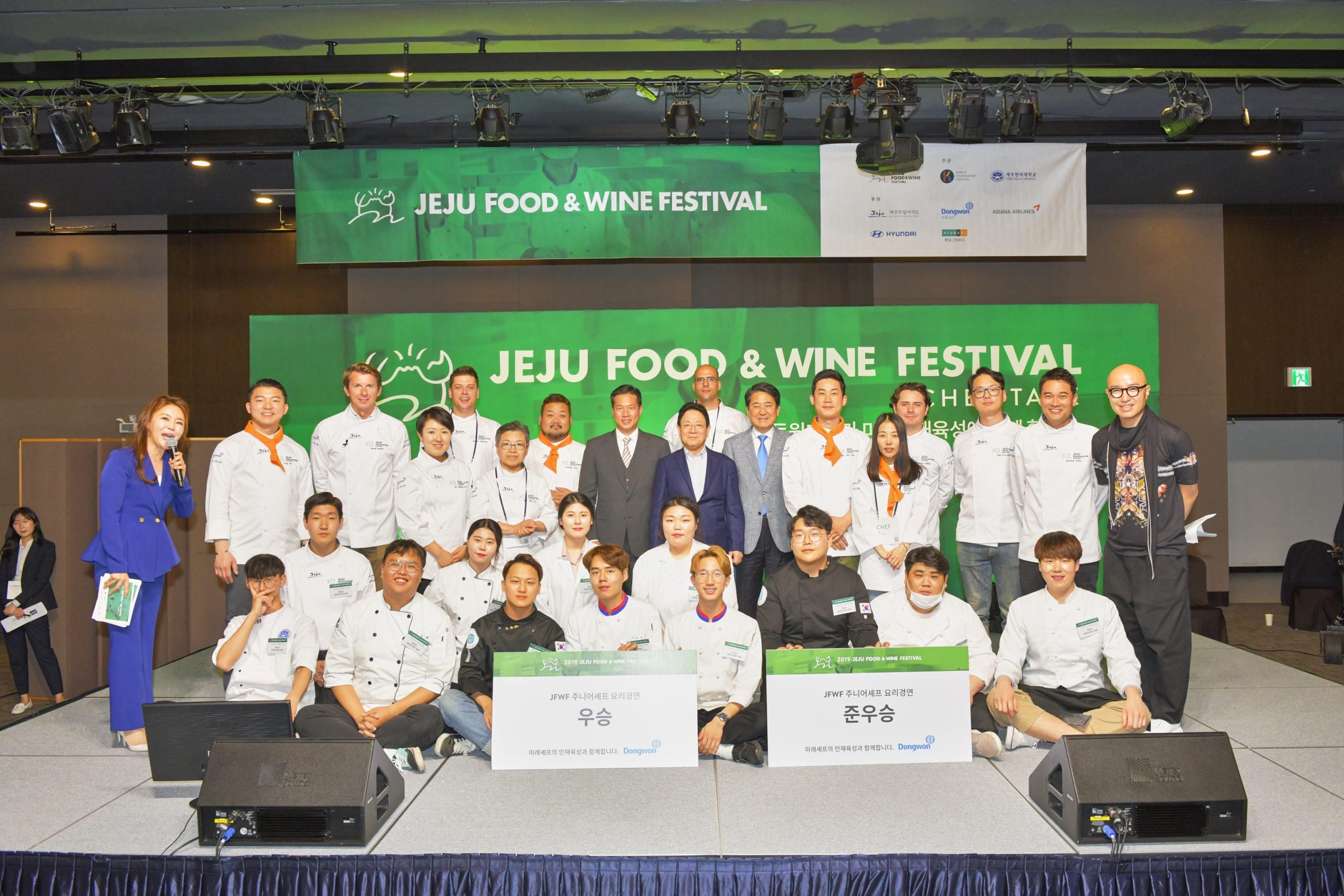A group photo of the winning team and runner-up team after the Junior Chef cooking contest.