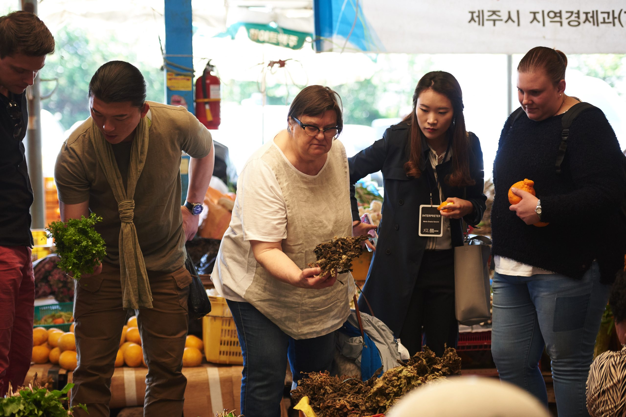 Tony Yoo, Michael Ashminov and Maria Songcini Chef's tour of the Jeju market that opens every five days